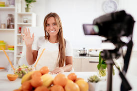 video production pricing : Woman in kitchen recording video