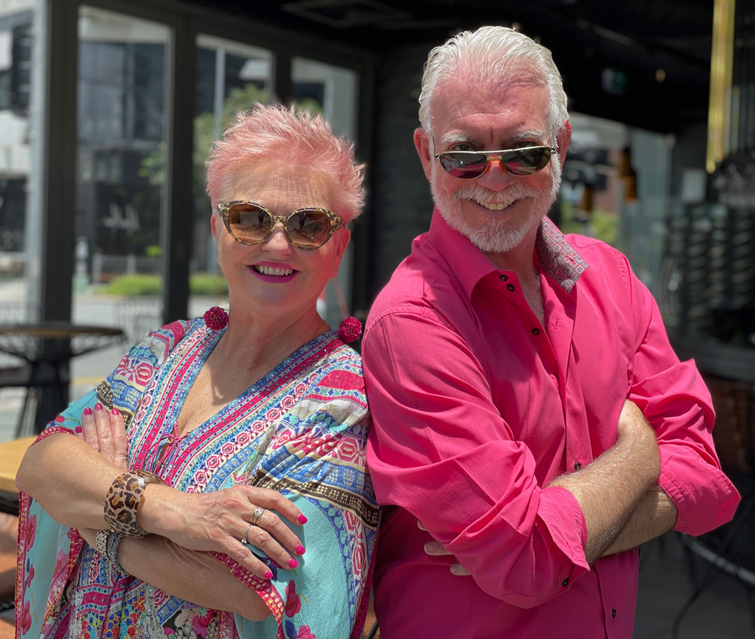 POP-TV co-hosts Benita Orwell and Lloyd Johnson posing outside a Broadbeach Queensland restaurant